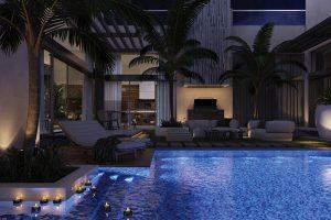 V rámci vizuálu vznikla i velkolepá obytná terasa s bazénem. Jestli jsou reálnou součástí finální realizace skutečné vzrostlé palmy, sice nevíme, ale s venkovním nábytkem a relaxačními kouty se určitě počítalo. U bazénu zaujme relaxační lehátko GIO od Antonia Citteria pro B&B Italia.
