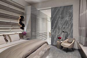 Záhlaví postele je obložené saténovým čalouněním, které izoluje místnost před hlukem z ostatních částí bytu. Mramorová stěna tvoří designovou spojnici s koupelnou.